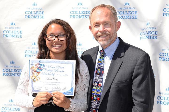 Chris Steinhauser presents award to Robinson K-8 School student Rosa Cruz