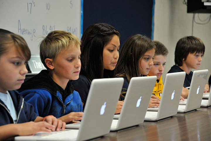 Line of students using computers